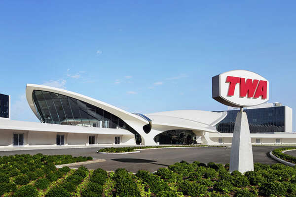Eero Saarinen's classic 1962 TWA Flight Center at New York JFK serves as the public areas for the new TWA Hotel.