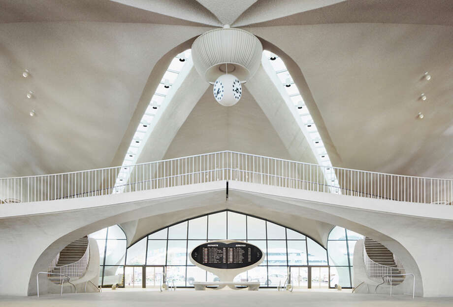 A old mechanical arrivals/departures board and a spherical clock adorn the hotel's lobby. Photo: TWA Hotel/David Mitchell