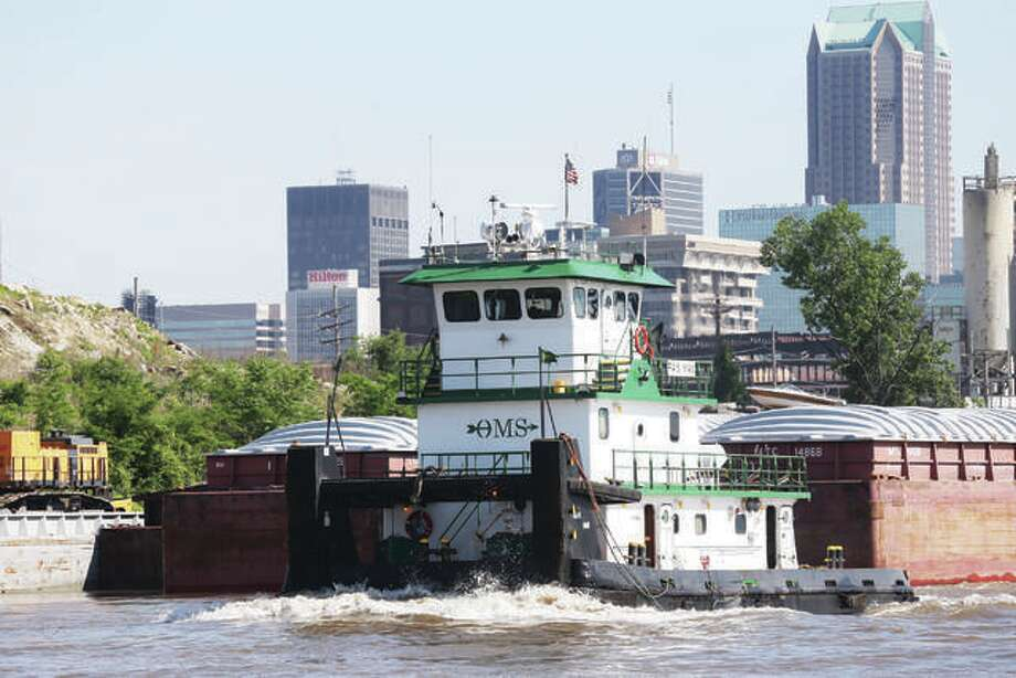 A barge and towboat make their way through the St. Louis area on the Mississippi River. Major repairs and renovations to the lock system on the Illinois River over the next few years will have a severe impact on commercial operations. One of the alternatives includes moving additional river traffic up and down the Mississippi River. Photo: For The Intelligencer