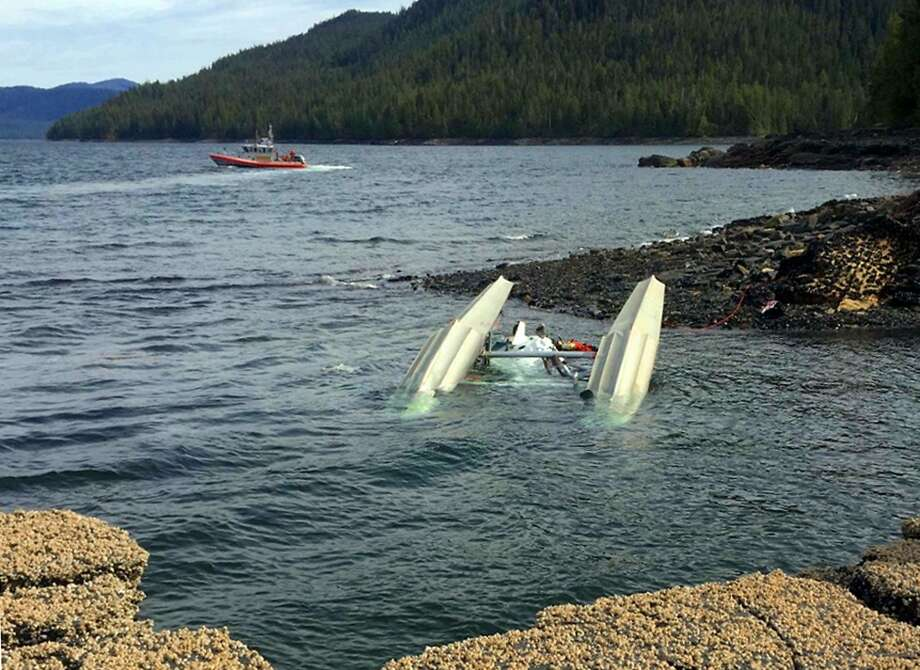 A Coast Guard boat crew searches for survivors of a downed float plane near the southeast Alaska town of Ketchikan. Photo: Ryan Sinkey / Associated Press