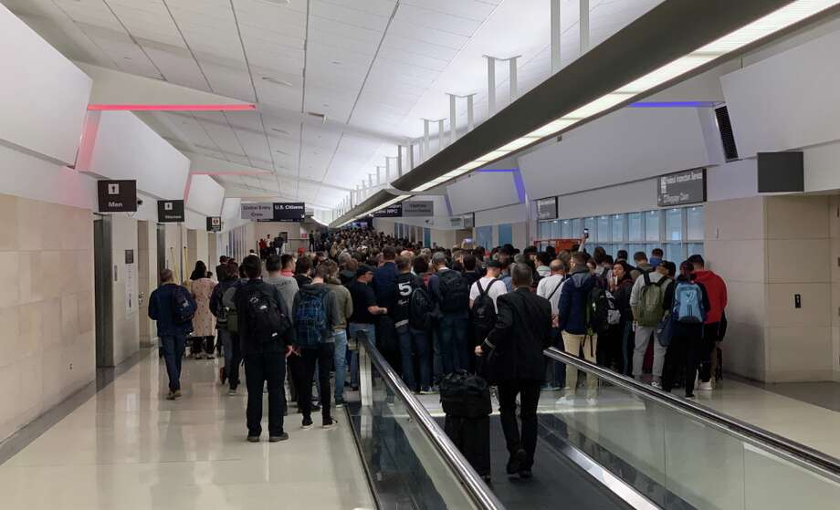 Hundreds, if not thousands, of travelers forced to stand in line for two hours to enter the US at SFO immigration Photo: Matthew Klint