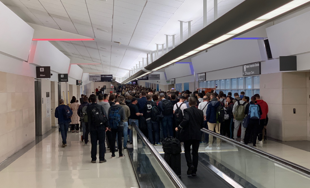 excruciating  travelers wait 2-3 hours in airport immigration lines