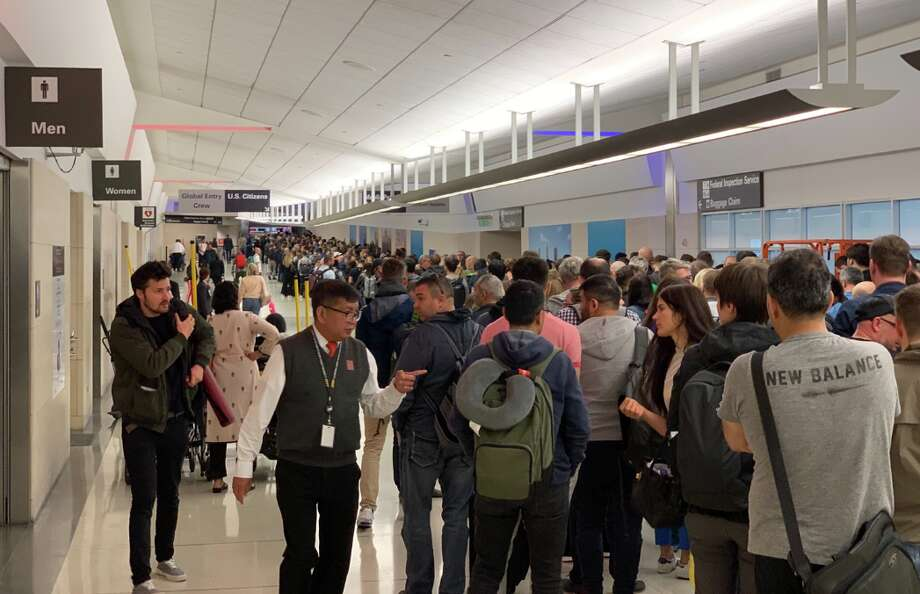 Crowded conditions like this at San Francisco's International Arrivals halls has travelers worried about novel coronavirus contagion Photo: Matthew Klint