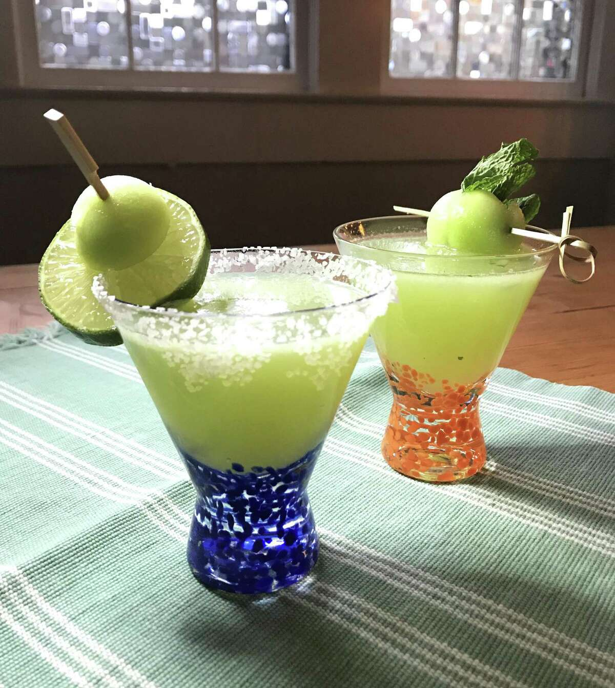 Two cocktails made with honeydew: Honeydew Margarita, left, and Honey, Do this Drink For Me