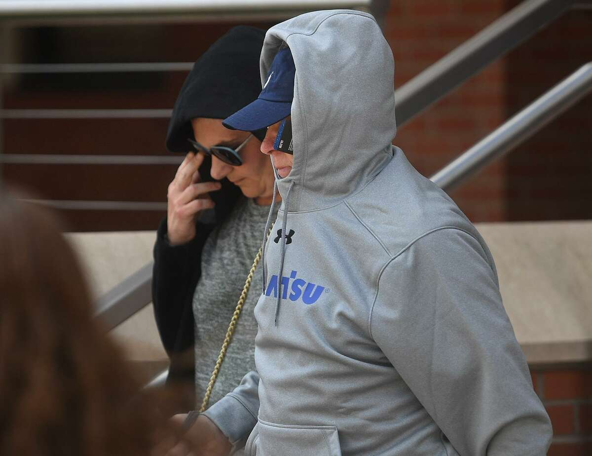 Accused killer James Taylor attempts to hide his identity as he exits Superior Court in Bridgeport, Conn. on Wednesday, May 15, 2019 after posting a $2 million bond for the February 3rd murder of his ex-wife Catherine Taylor.