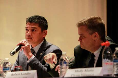 Daniel Albert, left, speaks during a debate among candidates for Houston ISD's Board of Education (For the Chronicle/Gary Fountain, October 16, 2017)