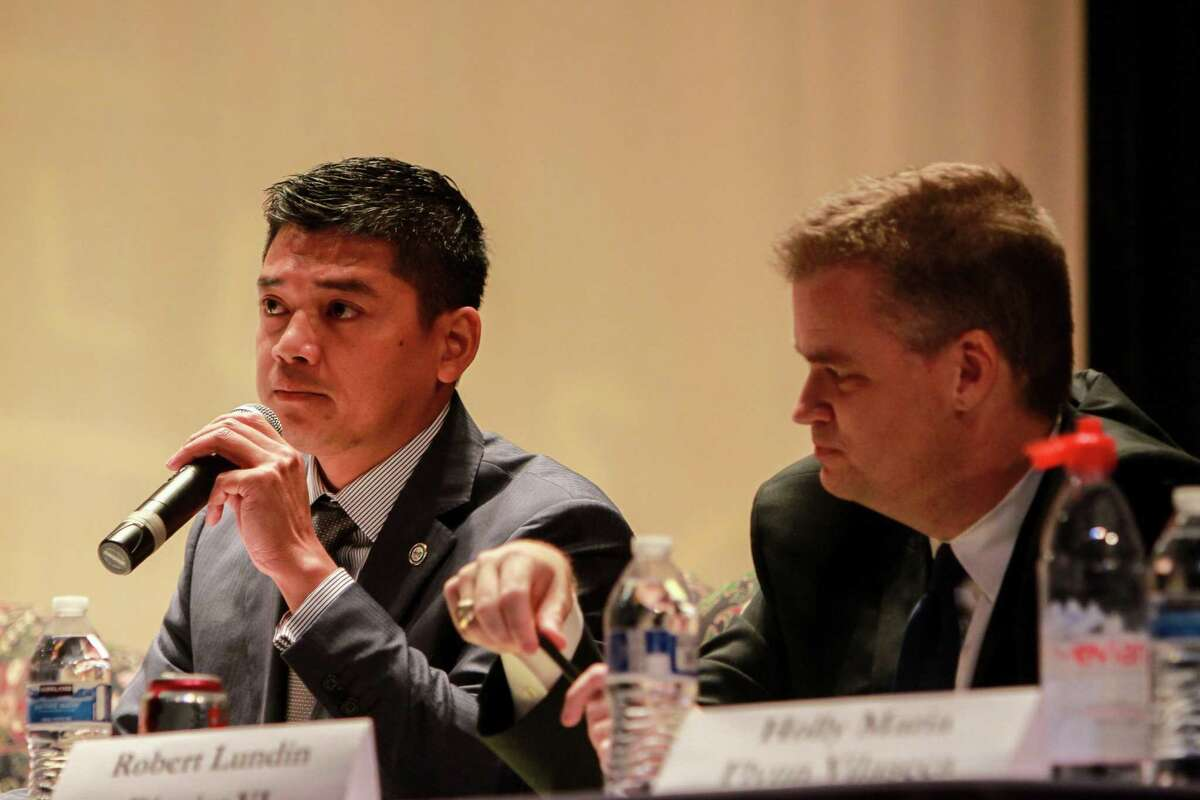 Daniel Albert, left, at a 2017 Houston ISD candidate event. Albert made an unsuccessful bid for a trustee seat that year.