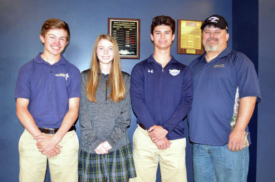 Father McGivney sophomores , left to right, Austin Callovini, Natalie Raymer and Blake Jones, along with coach Jeff Jones, will be representing FMCHS in the IHSA Bass Fishing State Tournament Friday and Saturday at Carlyle Lake. Photo: Scott Marion/The Intelligencer