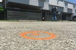 Spray paint marks the spot at a Houston-area apartment complex in Baytown, Texas, Tuesday, May 14 ,2019, where police say an officer shot and killed a woman after she hit him with his Taser during a struggle, shocking him. Police Lt. Steve Dorris said Tuesday that the officer shot at Pamela Turner after she hit him in the groin with the Taser. Dorris said Turner did not fire the stun gun but it shocked the officer when it struck him. Turner was pronounced dead at the scene. (AP Photo/John Mone)