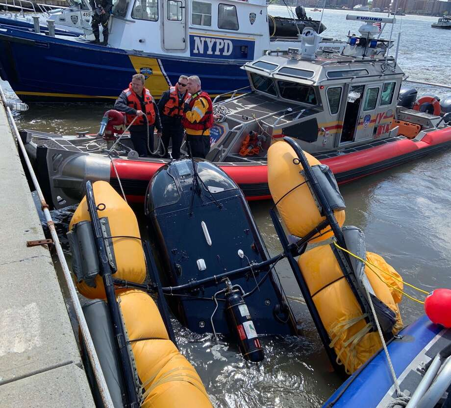 A helicopter crashed into the Hudson River near a busy Manhattan heliport Wednesday and partially sank, but not before the pilot was able to escape. New York City Fire Department officials said the pilot was not seriously injured after the helicopter landed in the river at around West 30th Street. No other people were aboard. Photo: FDNY