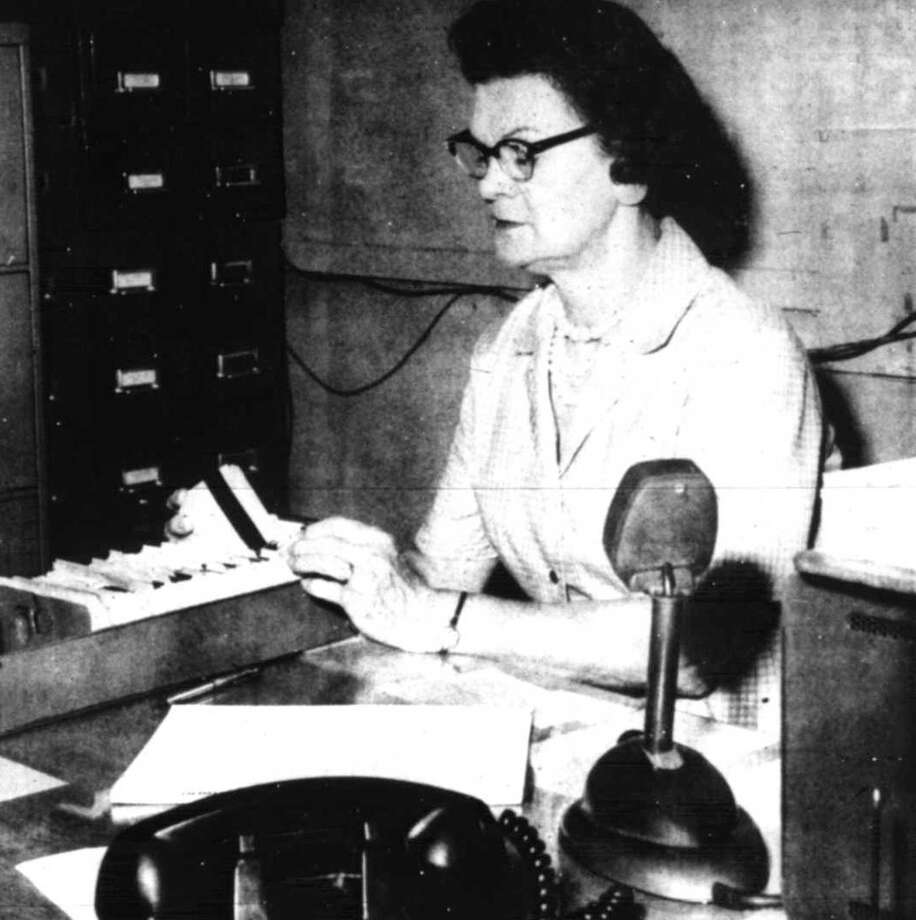 In 1964, Ina Redding served as the police dispatcher for the Conroe Police Department on the graveyard shift. Photo: Courier File Photo