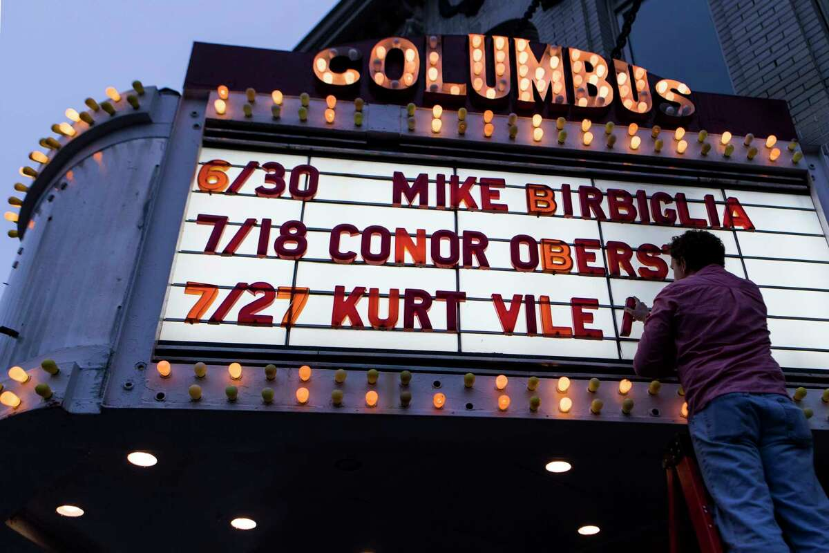 Shawn Schillberg, head of marketing and operations, changes the marquee at the Columbus Theatre in Providence, Rhode Island, on May 3, 2019.