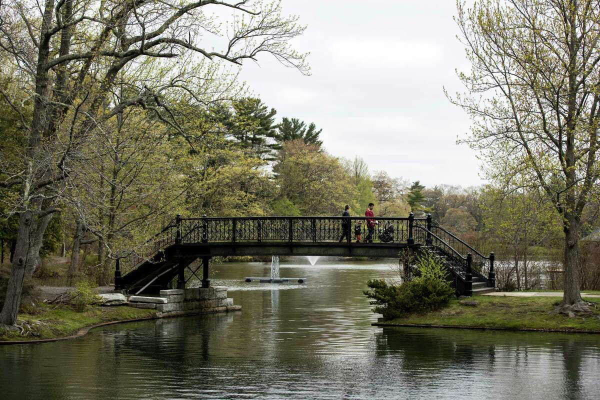 People cross the bridge at Roger Williams Park in Providence, Rhode Island, on May 3, 2019.