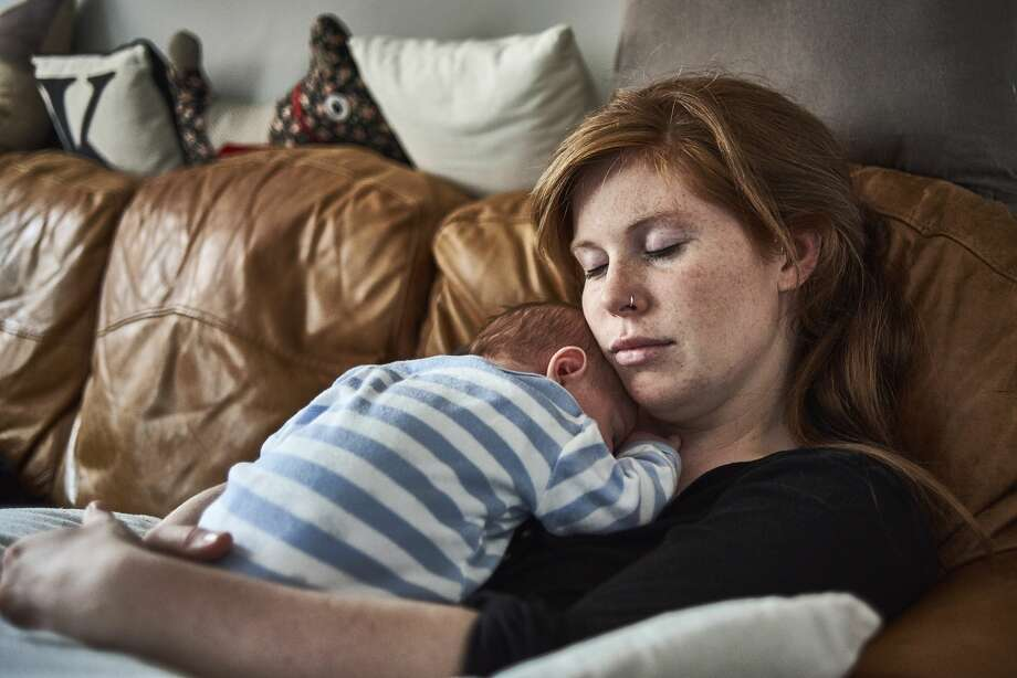 FILE: A mother and new born baby taking a nap together. Photo: Jamie Garbutt/Getty Images