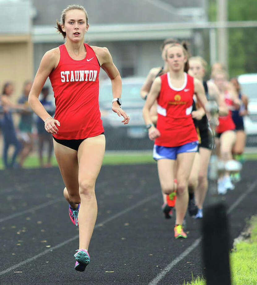 Staunton sophomore Lydia Roller (left) draws away from the rest of the field less than 200 meters into her first-place run in the 3,200 meters on May 8 at the Class 2A sectional in Springfield. Roller also won the 1,600 at the sectional and will be a contender in both races this weekend in the state meet in Charleston. Photo: Greg Shashack / The Telegraph