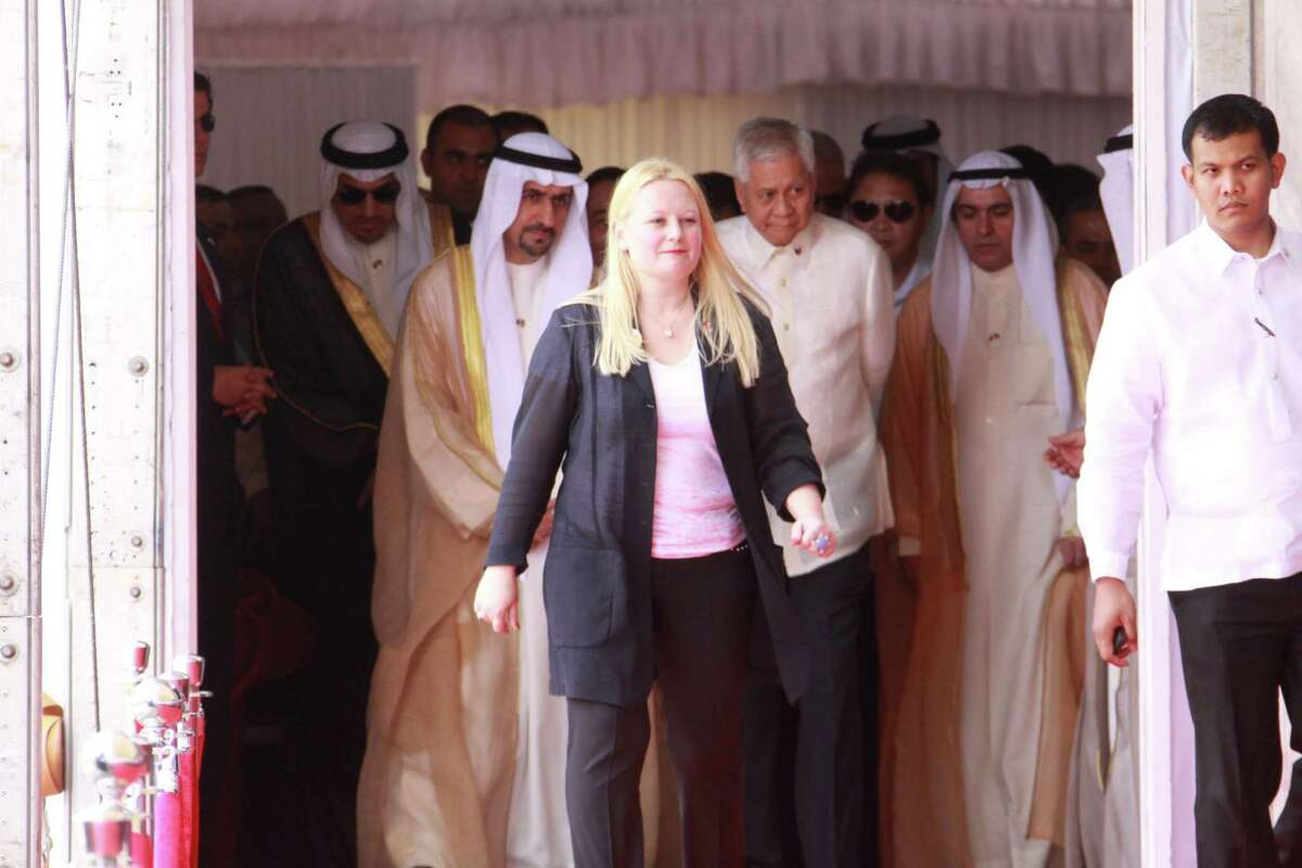 Marsha Lazareva, at a ceremony in the Philippines. Lazareva, a Russian citizen, is an investment manager whose embezzlement conviction in Kuwait was nullified by an appellate court. She faces other charges related to alleged financial crimes in Kuwait, where she is being held on $65 million bail. Neil Bush, of Houston, is part of a high-powered legal and lobby operation working on Lazareva's behalf.
