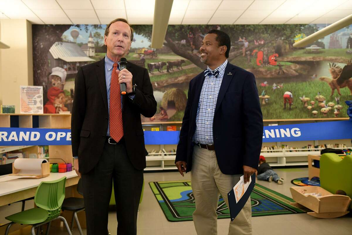 Neil Bush, left, the son of President George & Barbara Bush, makes his remarks with Director of Harris County Public Libraries Edward Melton during the ribbon cutting ceremony for the Barbara Bush Library Family Place on March 19, 2019.