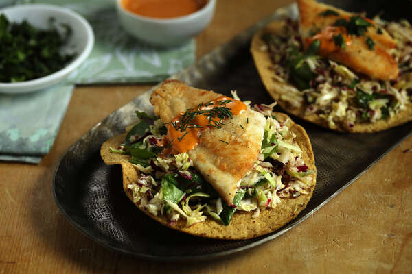 You can assemble the crispy fish and slaw tostadas at the last minute or let guests assemble their own. (E. Jason Wambsgans/Chicago Tribune/TNS)