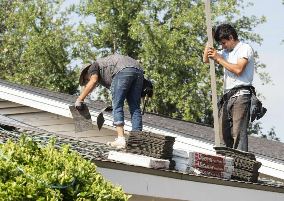 Roofing crews repair roofs around Midland 05/15/19 like these on a home on Fannin Ave. Tim Fischer/Reporter-Telegram Photo: Tim Fischer/Midland Reporter-Telegram