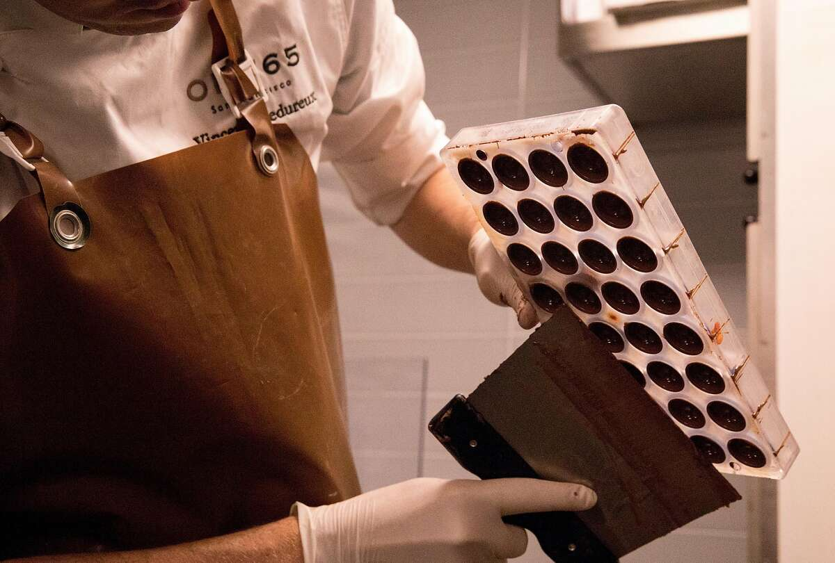 Chef Vincent Fredureux prepares a batch of handmade chocolates the second floor production level of One65 in San Francisco, Calif. Tuesday, May 14, 2019.