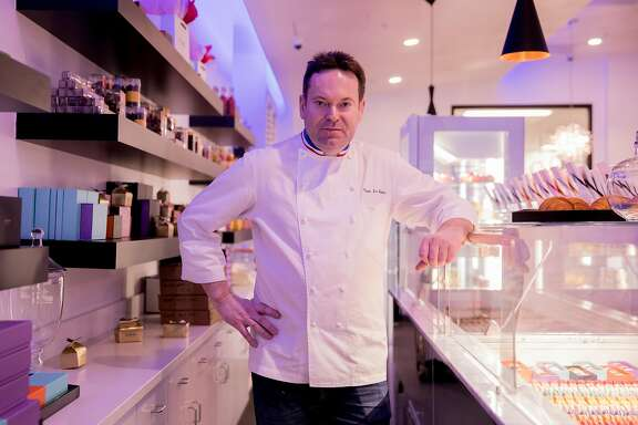 Head Chef Claude Le Tohic poses for a portrait behind the macaron counter at One65 in San Francisco, Calif. Tuesday, May 14, 2019.