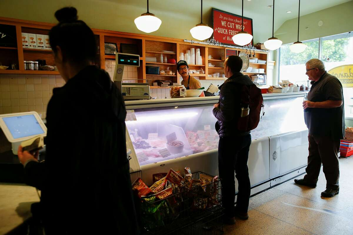 Matthew Arthur helps customers at Avedano's Meats on Wednesday, May 15, 2019, in San Francisco, Calif.