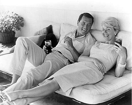 This undated file photo shows actress Doris Day  relaxing with actor Rock Hudson.Day and Hudson starred in several romance/comedy Hollywood films in the 1960s. Day died Monday, May 13, 2019, at age 97.