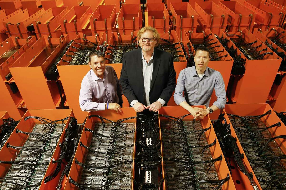 Bryan Bennett, Matt Lamont and Phil Schwam pose for a photo at Skybox Data Centers on Wednesday, May 15, 2019 in Katy. The supercomputer is made up of tens of thousands of servers, all immersed in chilled oil to cool them.