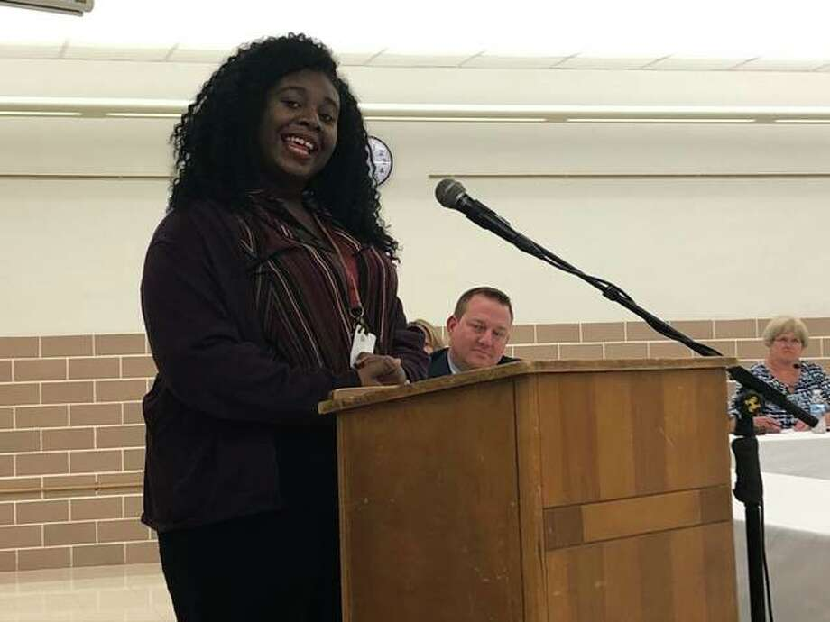 EHS junior, Scottlynn Ballard, recites a poem during a District 7 Board of Education meeting Monday following her National Poetry Out Loud win. Ballard recently placed second after advancing through a field of more than 275,000 contestants. Photo: Julia Biggs | The Intelligencer