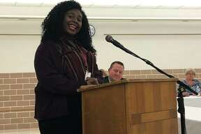 EHS junior, Scottlynn Ballard, recites a poem during a District 7 Board of Education meeting Monday following her National Poetry Out Loud win. Ballard recently placed second after advancing through a field of more than 275,000 contestants.