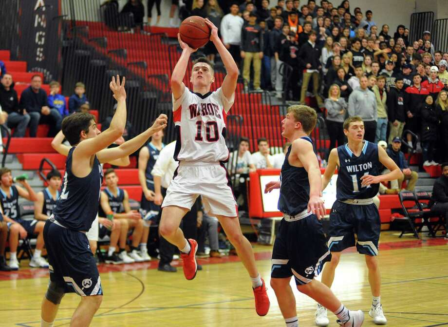 Former Fairfield Warde guard Sean Conway attempts a shot against Wilton on Jan. 18, 2018, in Fairfield. Photo: Christian Abraham / Hearst Connecticut Media / Connecticut Post
