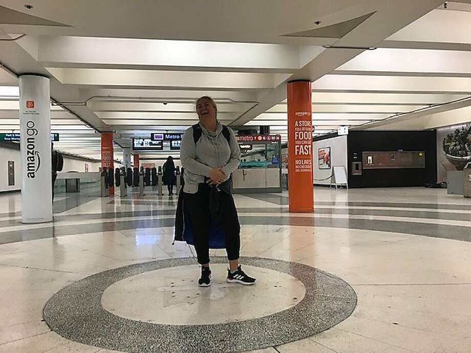 Bernie Brown, a visitor from New Zealand, hums a few bars of the New Zealand national anthem at the quirky Montgomery Street BART station echo chamber. Photo: By Kevin Fagan/The Chronicle