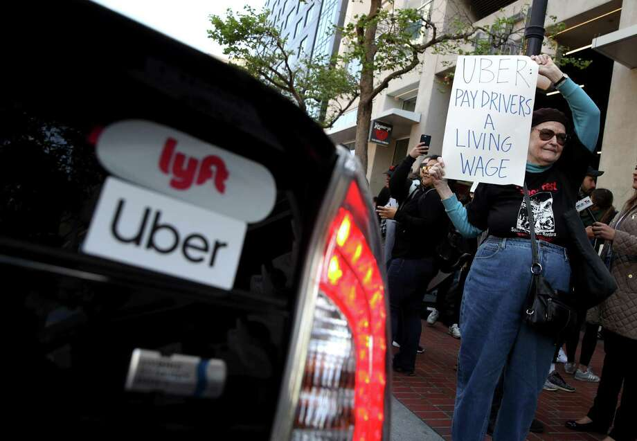 A supporter of ride share drivers from Uber and Lyft holds a sign during a protest in front of Uber headquarters May 8 in San Francisco, Calif. A reader says Uber and Lyft drivers should just quit. Photo: Justin Sullivan /Getty Images / 2019 Getty Images