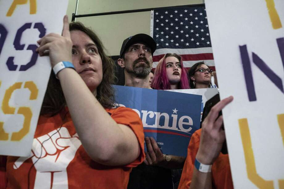 A crowd listens as Sen. Bernie Sanders (I-Vt.) speaks in Davenport, Iowa, April 5. Just because there are more than 20 Democrats running for president doesn't mean Trump is as vulnerable as supposed. Photo: JORDAN GALE /NYT / NYTNS