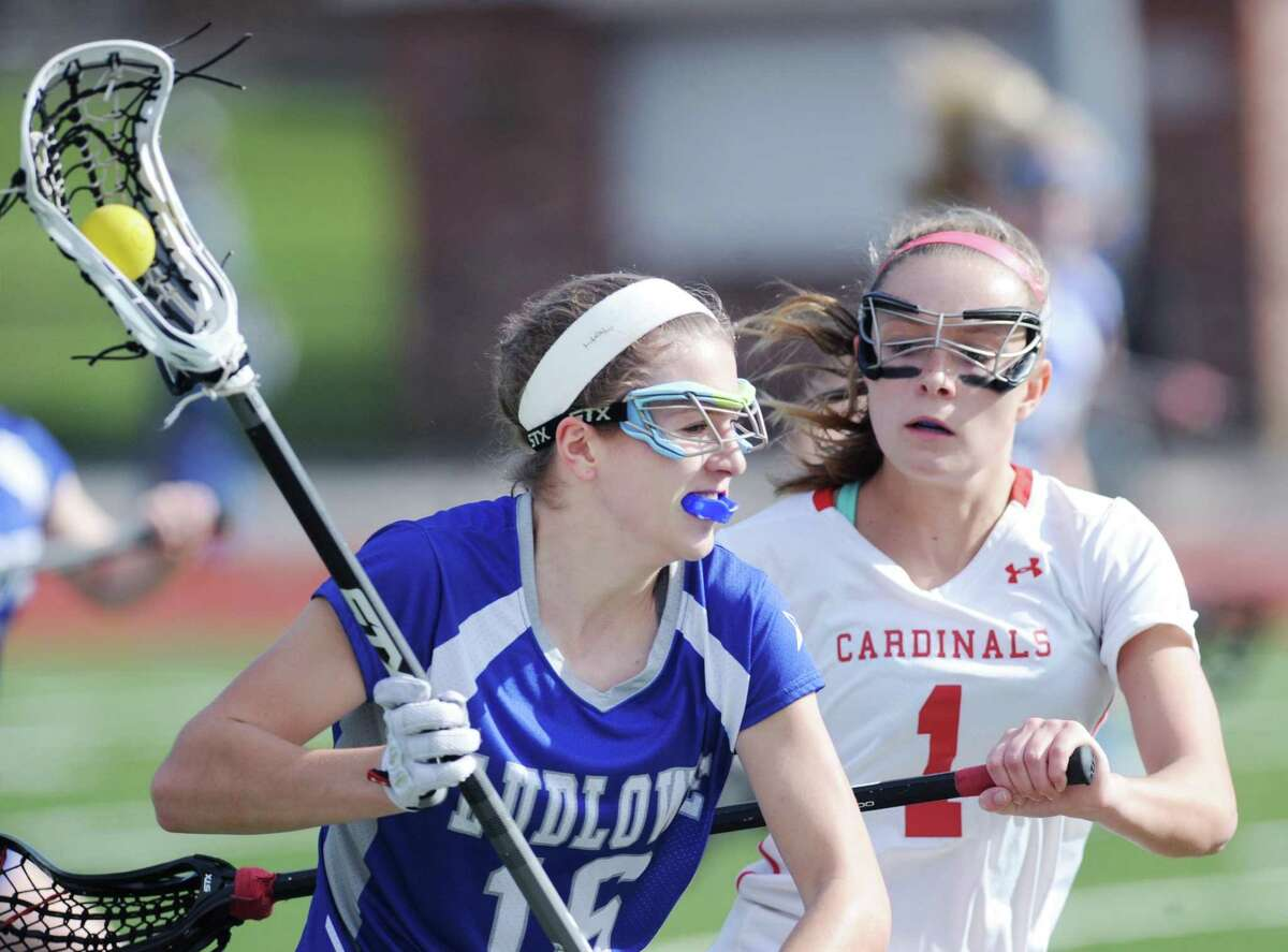 Fairfield Ludlowe's Ashley Moynahan, left, leads a break while being defended by Greenwich's Maggie O'Gorman in an April 2017 game.