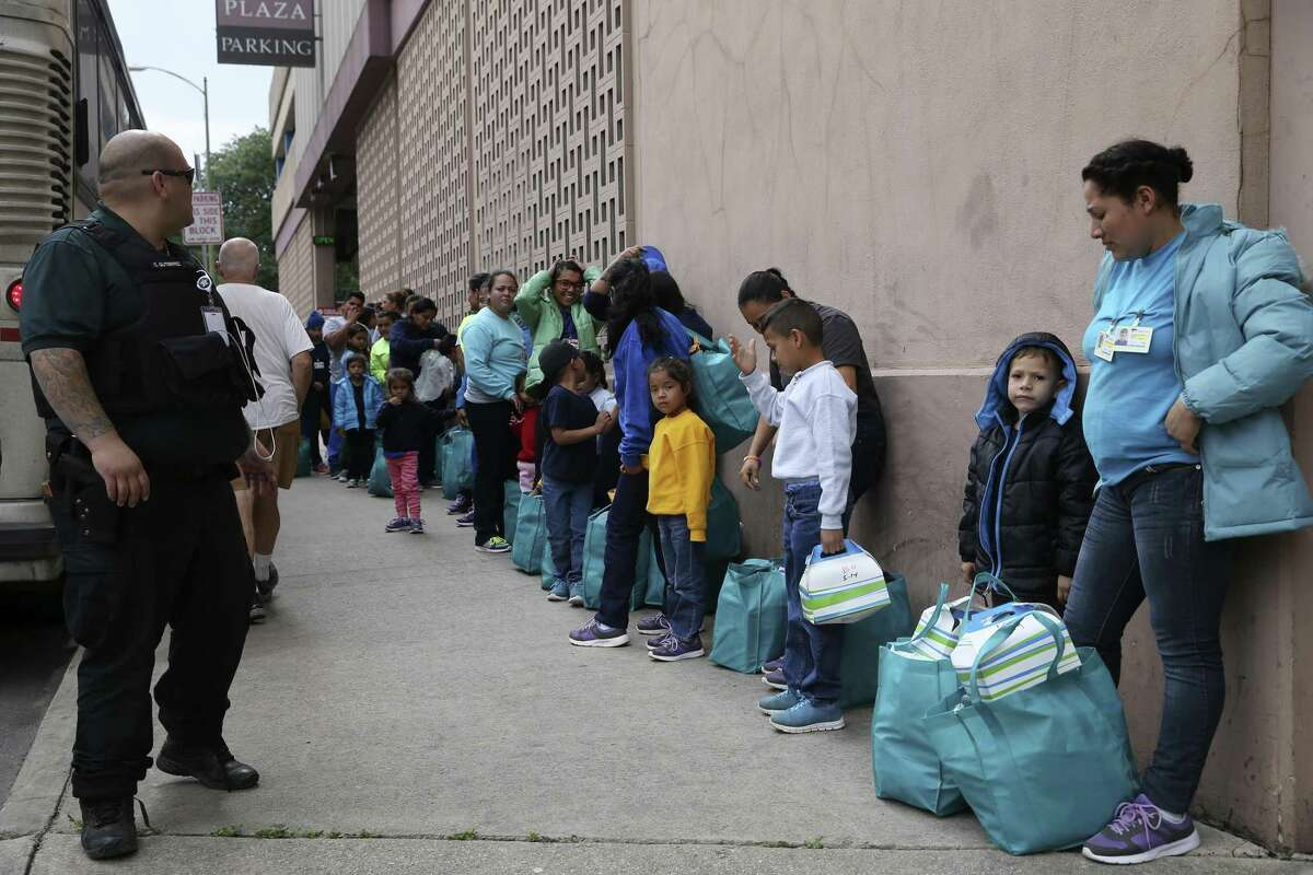 Migrants are dropped off across the street from the Greyhound Station in downtown San Antonio, Wednesday, May 15, 2019. Volunteers take the mostly Central American migrants from the station to the City of San Antonio Resource Center where they are provided with humanitarian needs. The center opened on March 30 and with help of nonprofits, has served around 8,000 according to City Manager Erik Walsh.