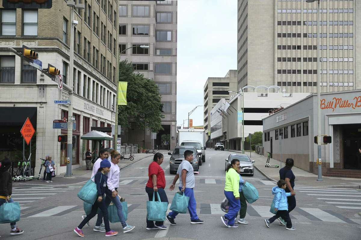 After their release from immigration detention, migrants make their way to the Greyhound Station after there are dropped off in downtown San Antonio, Wednesday, May 15, 2019. Volunteers take the mostly Central American migrants from the station to the City of San Antonio Resource Center where they are provided with humanitarian needs. The center opened on March 30 and with help of nonprofits, has served around 8,000 according to City Manager Erik Walsh.
