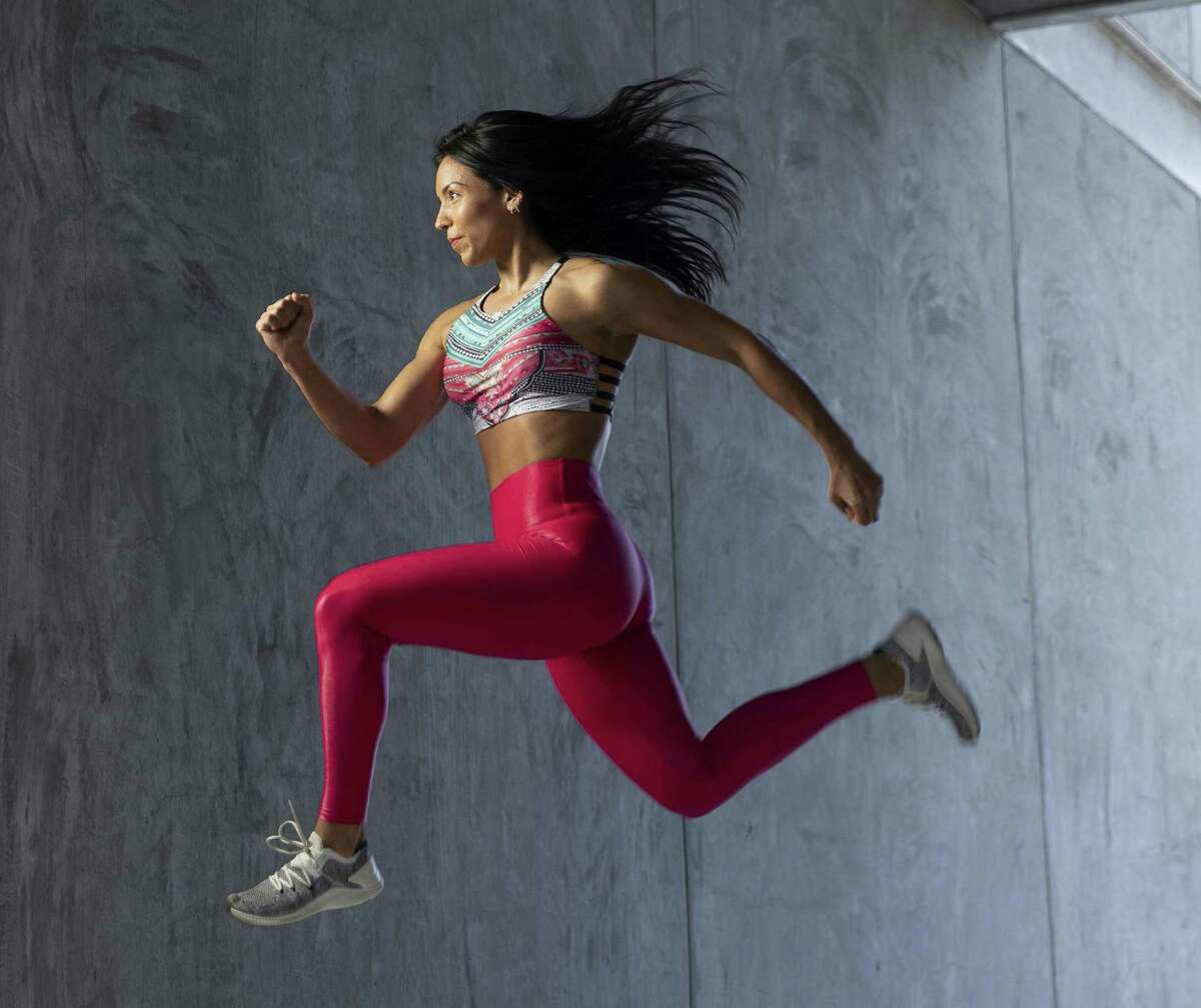 Carmen Morgan, a Houston fitness trainer, demonstrates her moves at Cindy Lisica Gallery.