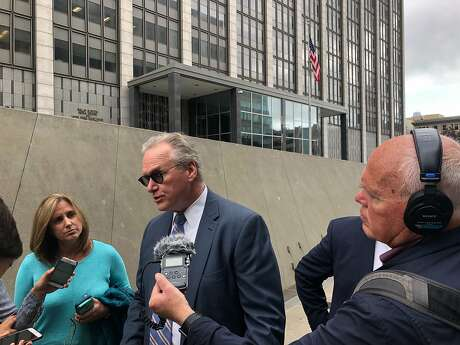 Bill Johnson, CEO of PG&E Corp., talks to reporters in May outside a federal courthouse in San Francisco. Johnson visited Sacramento Tuesday, though he declined to say which lawmakers he spoke with or whether he would meet with Gov. Newsom. Photo: J.D. Morris / The Chronicle