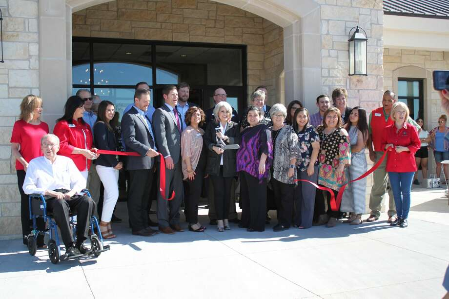 Centennial Bank, city officials and Plainview Chamber of Commerce members cut ribbon Tuesday at the bank's new location.  Photo: Alex Driggars/Courtesy Photo