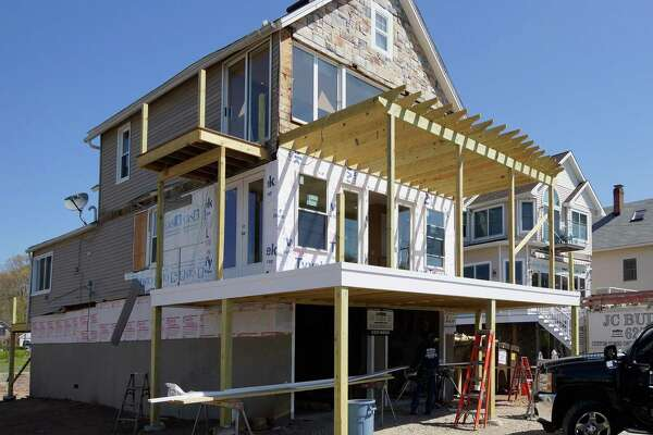 Branford--The house owned by the DeRosa's damaged by the storms last year now being raised and remodeled on Short Beach Road. Photo-Peter Casolino/Register pcasolino@newhavenregister.com