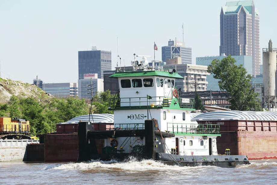 A barge and towboat make their way through the St. Louis area on the Mississippi River. Major repairs and renovations to the lock system on the Illinois River over the next few years will have a severe impact on commercial operations. One of the alternatives includes moving additional river traffic up and down the Mississippi River.