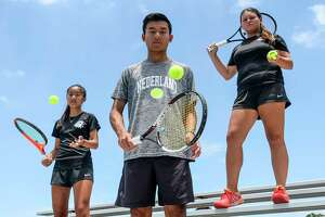 From left to right Megan Do, Brandon Do and Jayci Wong poses for a photo at the Nederland High School tennis courts Wednesday. The players are heading to College Station Photo taken on Wednesday, 05/15/19. Ryan Welch/The Enterprise