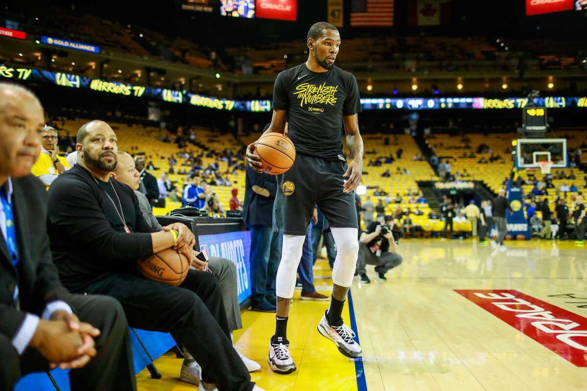 Kevin Durant warms up ahead of Game 5 of the Western Conference Semifinals between the Golden State Warriors and the Houston Rockets at Oracle Arena in Oakland, California, on Wednesday, May 8, 2019. The series is tied 2-2.