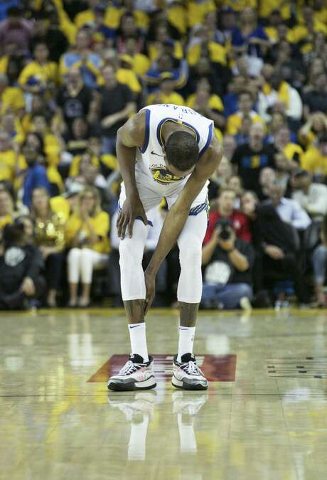 Golden State Warriors Kevin Durant checks his calf in the third quarter during game 5 of the Western Conference Semifinals between the Golden State Warriors and the Houston Rockets at Oracle Arena on Wednesday, May 8, 2019 in Oakland, Calif. Photo: Carlos Avila Gonzalez / The Chronicle / online_yes