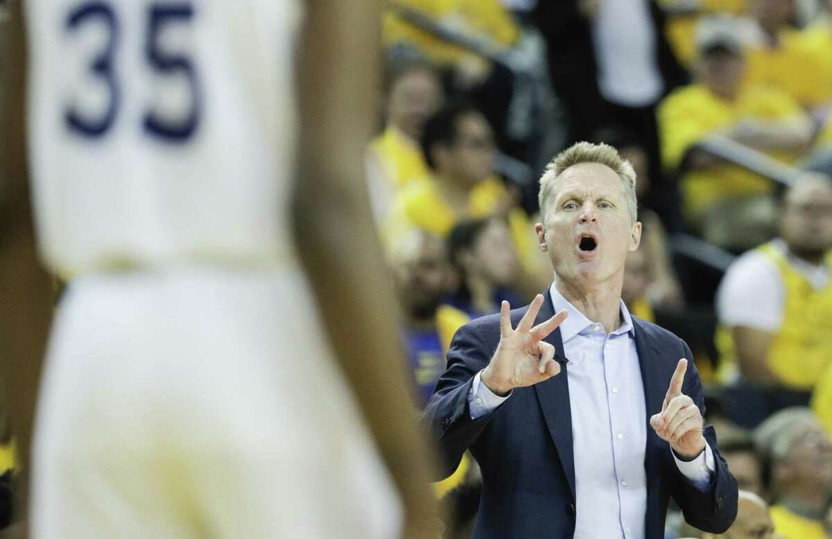 Golden State Warriors head coach Steve Kerr signals a play to Kevin Durant in the third quarter during game 5 of the Western Conference Semifinals between the Golden State Warriors and the Houston Rockets at Oracle Arena on Wednesday, May 8, 2019 in Oakland, Calif.