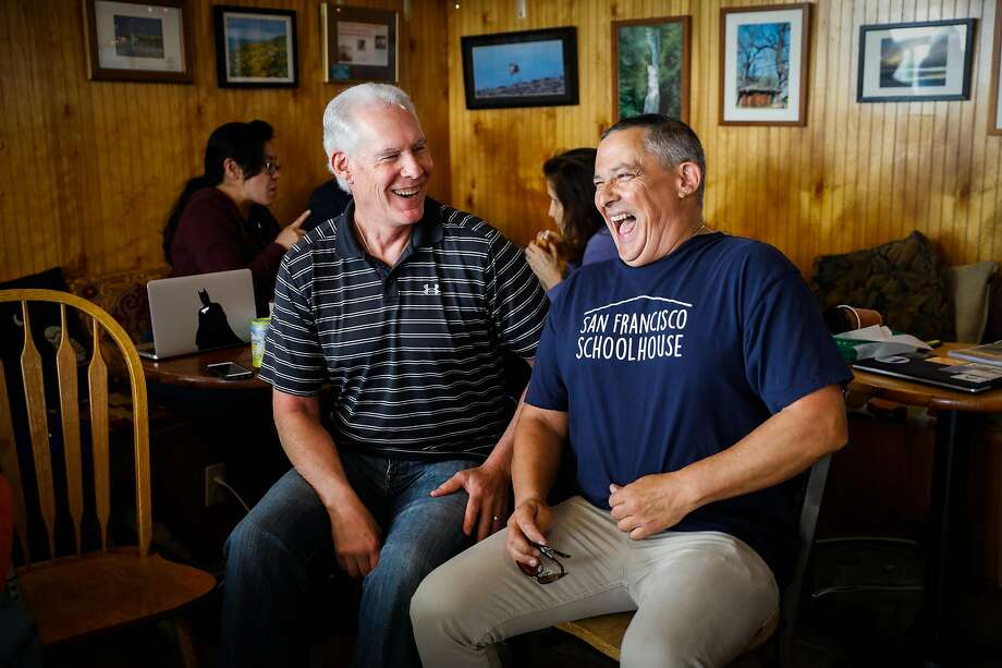Carlos Aguilar (left) spends time with younger brother Mark Patron at the Chit-Chat Cafe in Pacifica. Aguilar, who was adopted at 2 months old, found out less than a year ago that he has five full siblings, including Patron. Photo: Gabrielle Lurie / The Chronicle