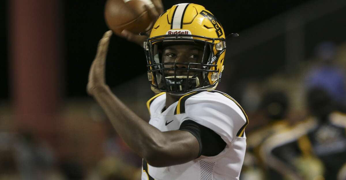 Marshall quarterback Malik Hornsby warms up before a game against Madison at Butler Stadium on Friday, Nov. 9, 2018, in Houston.