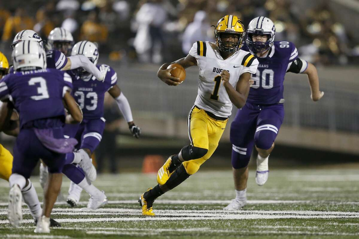 Fort Bend Marshall Buffalos quarterback Malik Hornsby (1) runs the ball in the third quarter pursued by Port Neches-Groves Indians Joshua Patteson (90) during the high school football playoff game between the Port Neches-Groves Indians and the Fort Bend Marshall Buffalos in Baytown, TX on Friday, November 30, 2018.