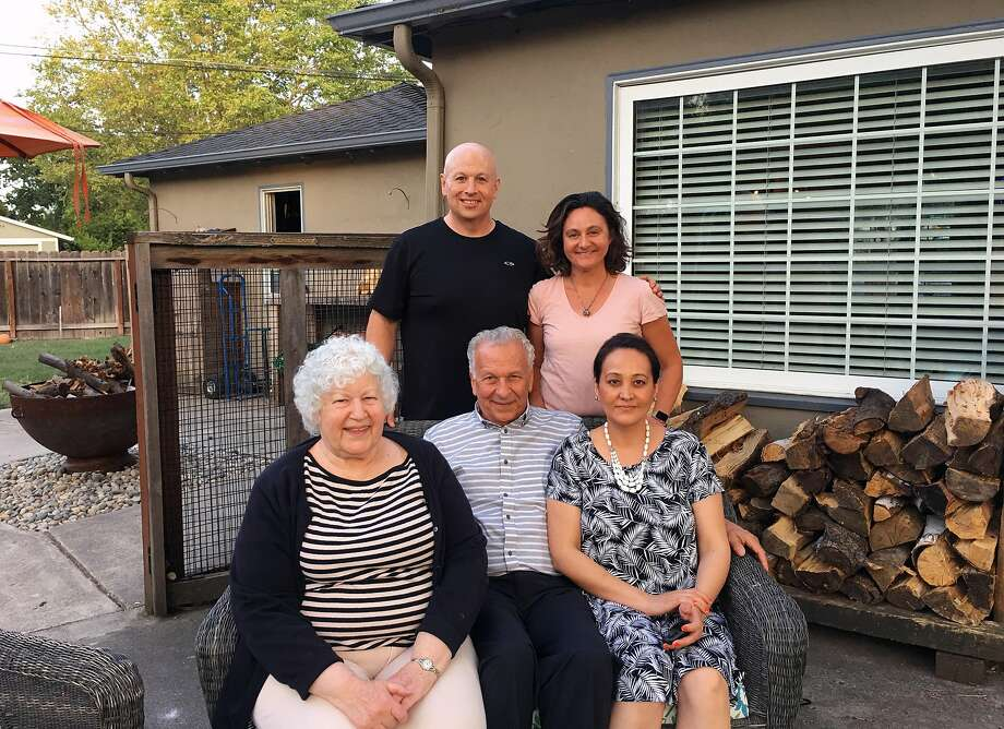 One week after learning that she had a half brother and many extended family members she never knew existed, Claudia Bogner met her new nephew at his home in Walnut Creek. Seated: Claudia Bogner; Paul Bogner, the brother she grew up with; and Paul's wife, Maria. Standing: Nephew Benjamin Bogner with his wife, Leila. Photo: Courtesy Claudia Bogner